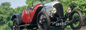 A vintage red legendary Bentley 3-Litre on a country road | Bentley Motors