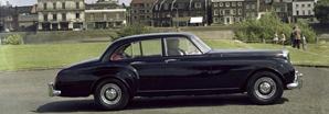A black S1 Continental on a 50s British  city road | Bentley Motors
