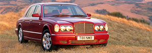 A scarlet red original Bentley Arrange parked in the country side | Bentley Motors