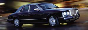 The traditional and powerful Bentley Arnage R being driven on a city road | Bentley Motors