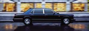 The unique personalisable Bentley Arnage RL driving in a city road | Bentley Motors