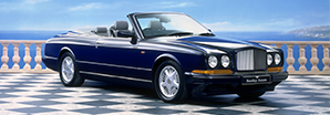 The original convertible Bentley Azure parked on a elegant seaside terrace | Bentley Motors