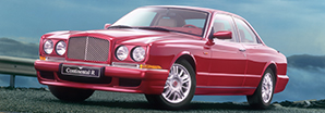 The red Bentley Continental R parked on the cliff side overlooking the sea | Bentley Motors