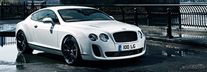 The crystal white 2009 Bentley Continental Super Sports parked next to the river | Bentley Motors