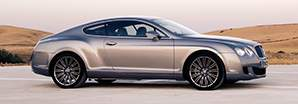Side view of the first generation Bentley Continental GT next to a field | Bentley Motors