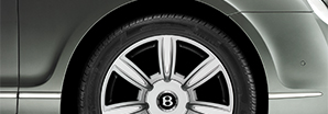 A magnified side shot of the grey Bentley Continental Flying Spur wheel | Bentley Motors