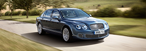 A blue first generation Bentley Continental Flying Spur driving along a country road | Bentley Motors