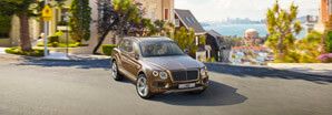 bentayga-w12-driving-through-city-street-carousel-298x104.jpg