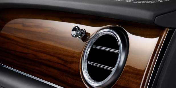 The Bentley Bentayga Diesel air vent with a veneered wood finish | Bentley Motors