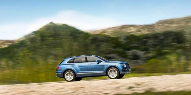 The Bentley Bentayga Diesel SUV driving up a mountain road | Bentley Motors