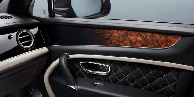 Custom car interior design on the passenger side door of the Bentayga Mulliner | Bentley Motors