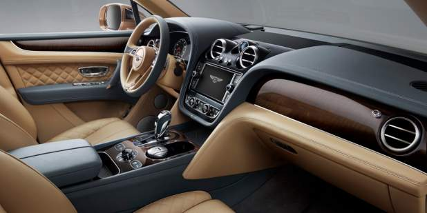 The tan and black leather front interior of a Bentley Bentayga SUV | Bentley Motors