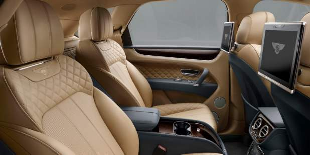 Rear passenger seat tablets and tan leather interior of a Bentley Bentayga | Bentley Motors