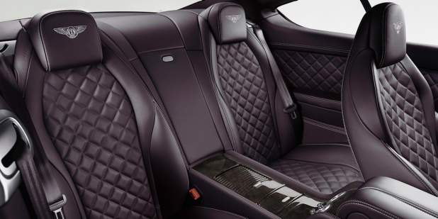 Rear passenger view of the quilted leather seats in a Continental GT | Bentley Motors