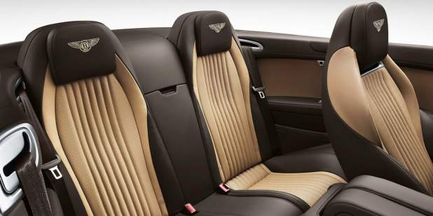 Rear cabin with two tone leather interior of the Bentley Continental GT Convertible | Bentley Motors