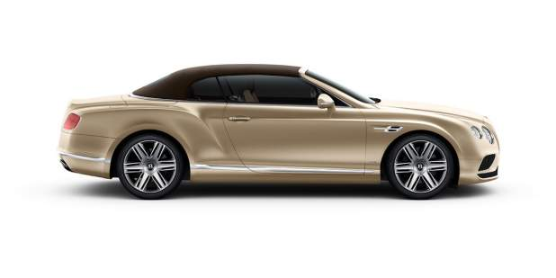 Side view of a gold Bentley Continental GT Convertible with the roof up | Bentley Motors