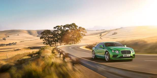 Apple green Continental GT Speed in the countryside with a rear view of fields | Bentley Motors