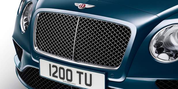 Front grille and headlamps on a dark blue Continental GT V8 | Bentley Motors