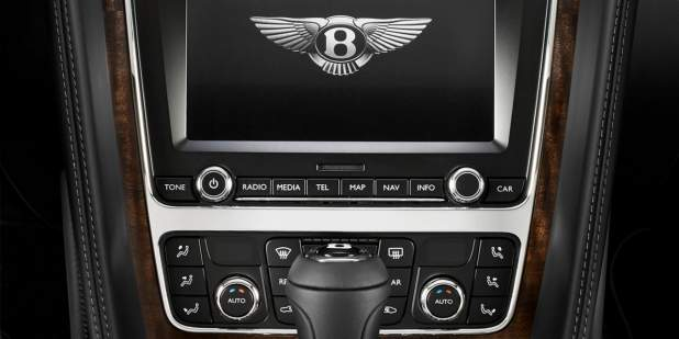 Centre console of a Bentley Continental GT V8 with leather and veneer finish with multimedia screen | Bentley Motors