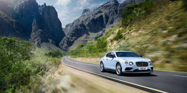 Light blue Bentley Continental GT V8 S driving on a mountain road |Bentley Motors