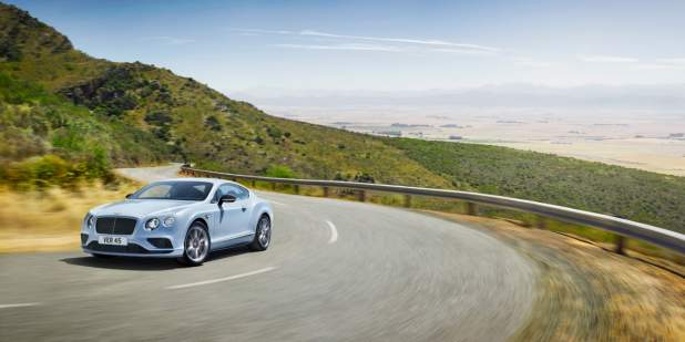 Light blue Bentley Continental GT V8 S driving up a hill side road | Bentley Motors
