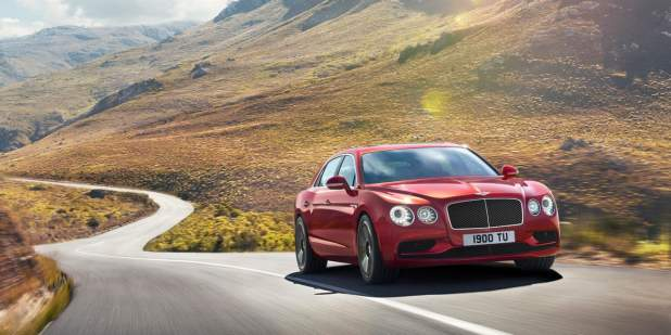 Red Bentley Flying Spur V8 S driving on a country road | Bentley Motors