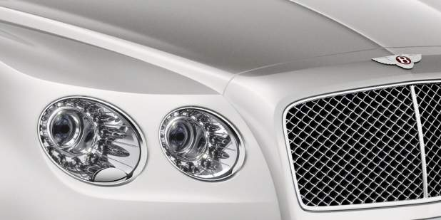 Right headlamps, grille and Bentley emblem on a silver Bentley Flying Spur V8 | Bentley Motors