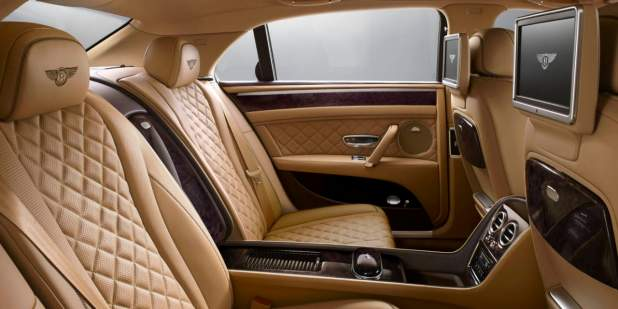 Bentley Flying Spur rear cabin with light brown quilted seats and entertainment screens | Bentley Motors
