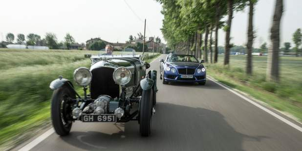 Heritage Bentley Blower driving on a country road in front a convertible | Bentley Motors