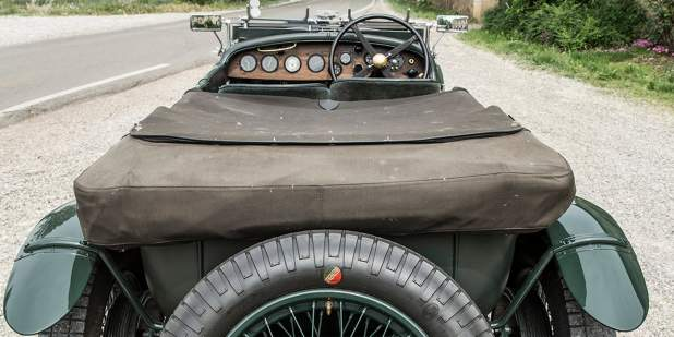Rear view of a heritage Bentley Blower parked on the road side | Bentley Motors