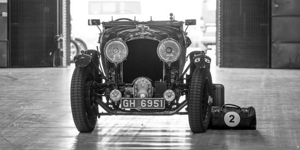 A front profile view of a heritage Bentley Blower in black and white | Bentley Motors