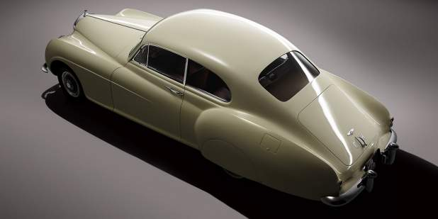 Rear view of a pearl coloured Bentley R-type Continental | Bentley Motors
