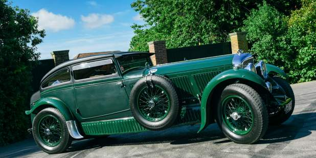 Dark green heritage Bentley Blue Train parked in a driveway | Bentley Motors