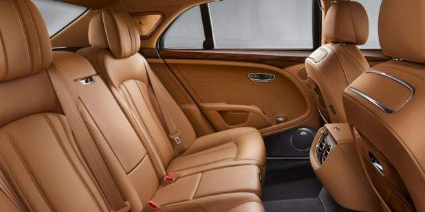 Rear cabin of a Bentley Mulsanne with complete tan leather interior | Bentley Motors