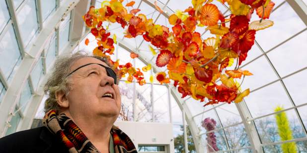 Dale Chihuly admiring his colourful glass art in a glass-roof conservatory   Bentley Motors