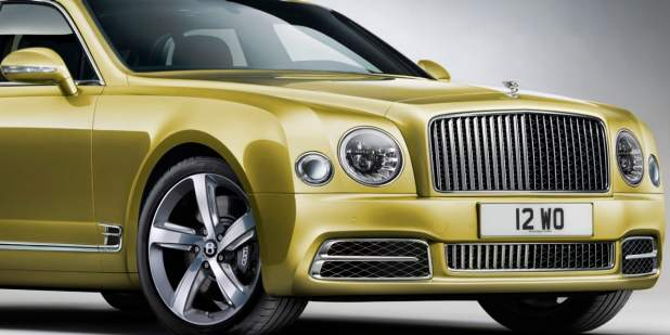Front view of headlamps, front wheel and grille on a Bentley Mulsanne Speed | Bentley Motors