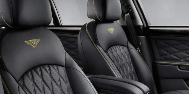 Black leather quilted front seats with yellow contrast stitching in a Bentley Mulsanne Speed | Bentley Motors