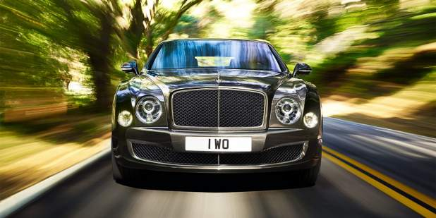Front view of a Bentley Mulsanne Speed driving on a country road in grey Spectre paint |Bentley Motors