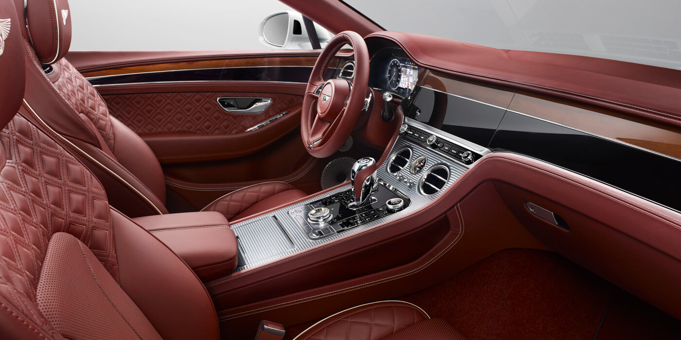 Front interior of new Continental GT Convertible in Cricket Ball leather