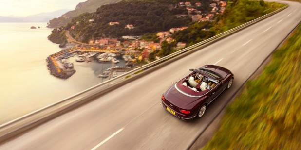 new-Cricket-Ball-red-Bentley-Continental-GT-Convertible-driving-in-Italy-near-seaside-town