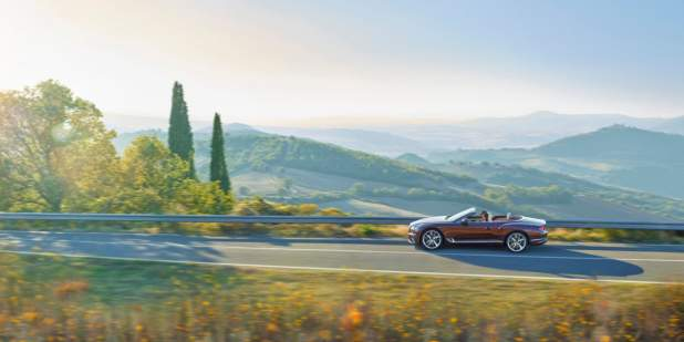 new-Cricket-Ball-red-Bentley-Continental-GT-Convertible-driving-on-high-mountain-road