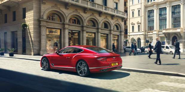 New-Continental-GT-V8-driving-past-city-square