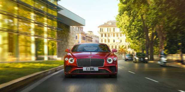 New-Continental-GT-V8-driving-past-park