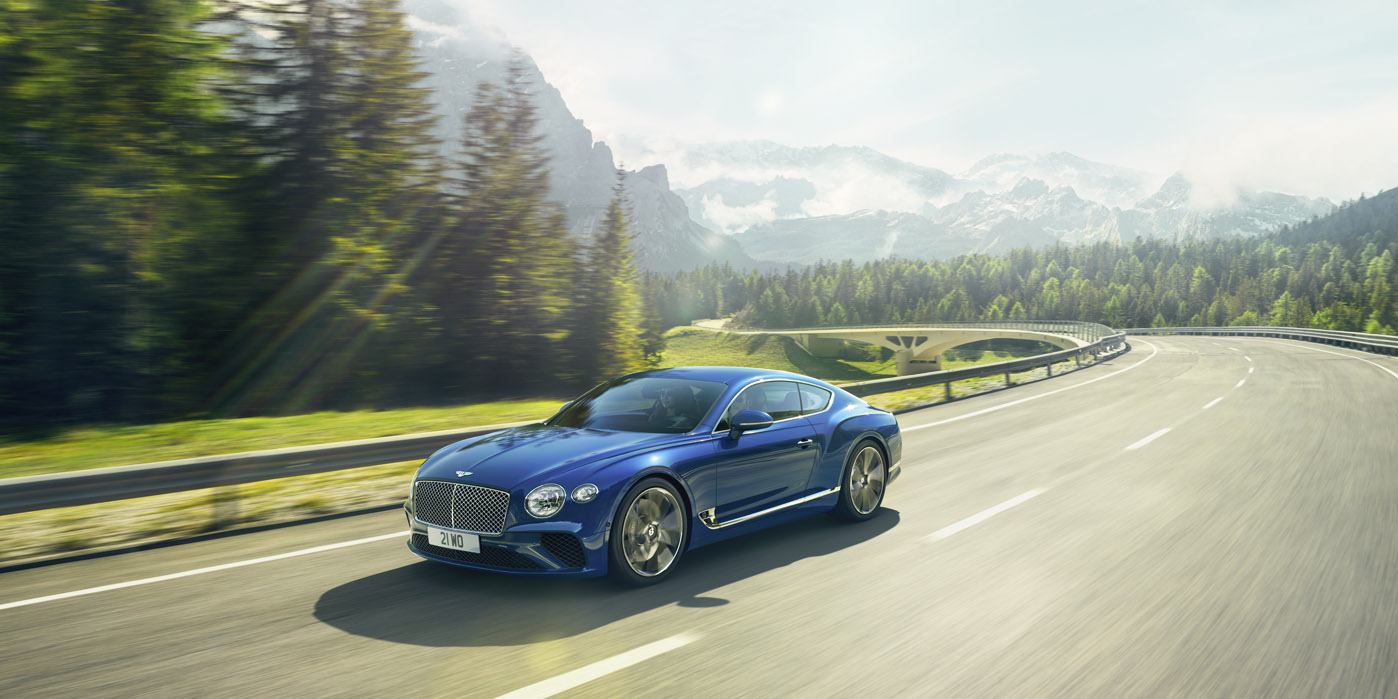 New Continental GT in Sequin Blue paint colour driving on an Italian road