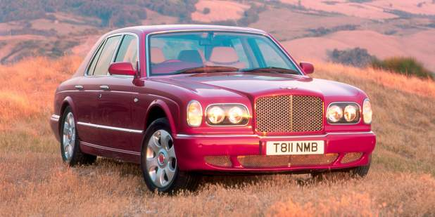 Front view of a red Bentley Arnage parked in a field | Bentley Motors