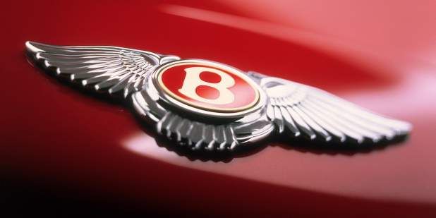 Close up of the Bentley Winged B emblem on a red Bentley Arnage saloon | Bentley Motors