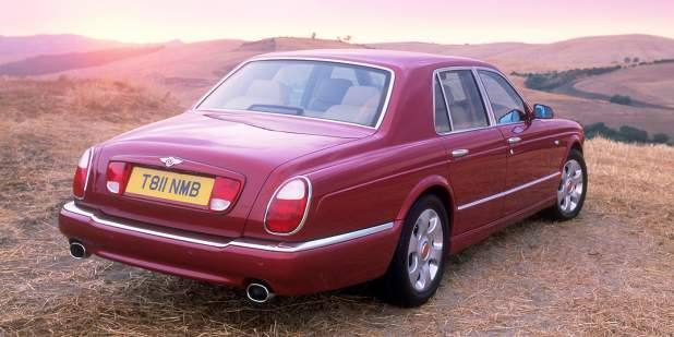 Rear view of a a red Bentley Arnage parked in a field | Bentley Motors