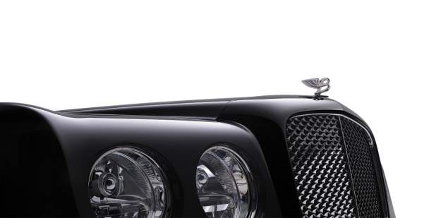 Right side of headlamps and Flying B emblem on black Bentley Arnage Final Series | Bentley Motors