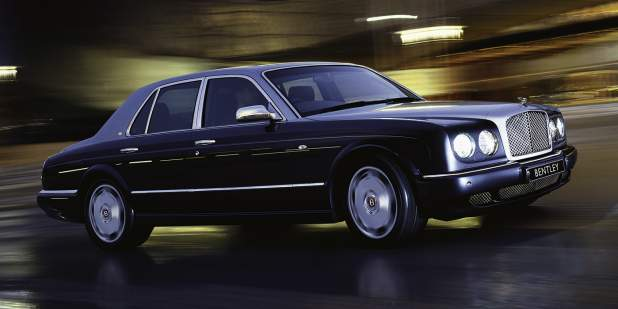 Side profile of a duo-toned Bentley Arnage R driving at night | Bentley Motors