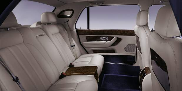 Rear cabin of a Bentley Arnage RL with leather seats and veneer finish | Bentley Motors